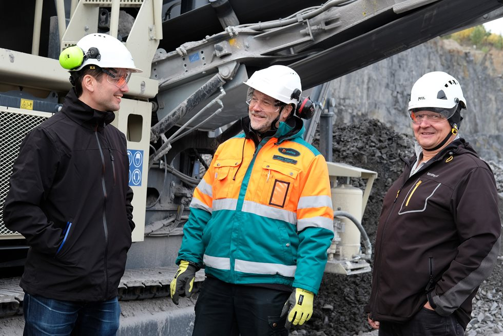 Three employees at the VRJ Group site