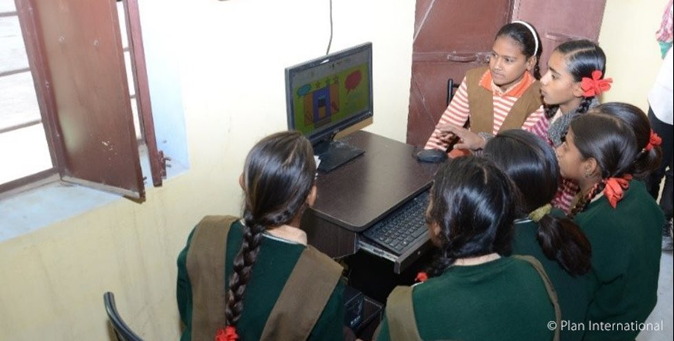Girls studying with computer in India.