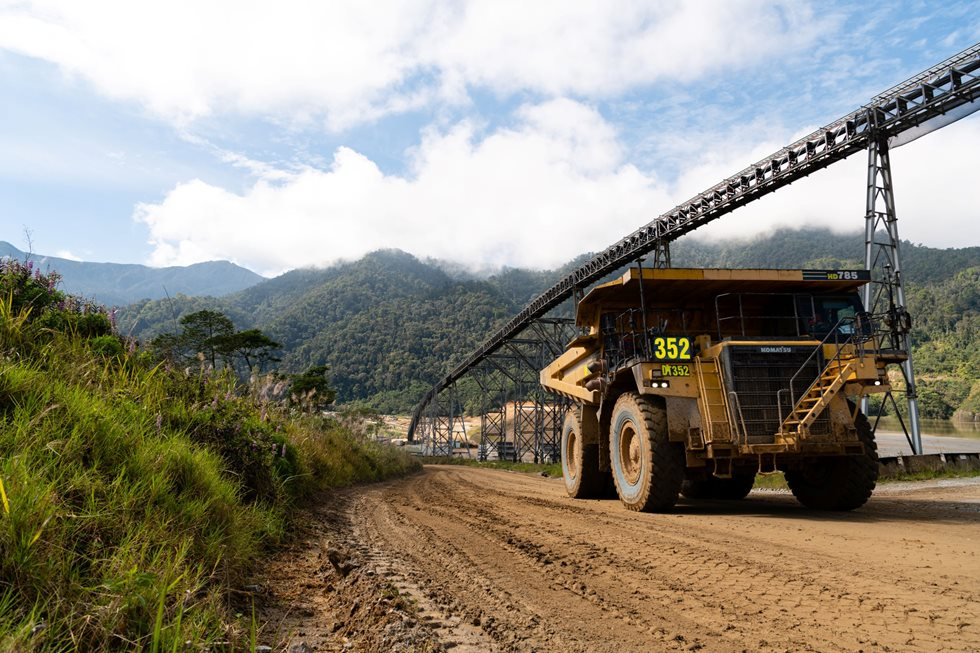 The overland conveyor minimises the use of heavy haul trucks on the road between the pit and processing plant.