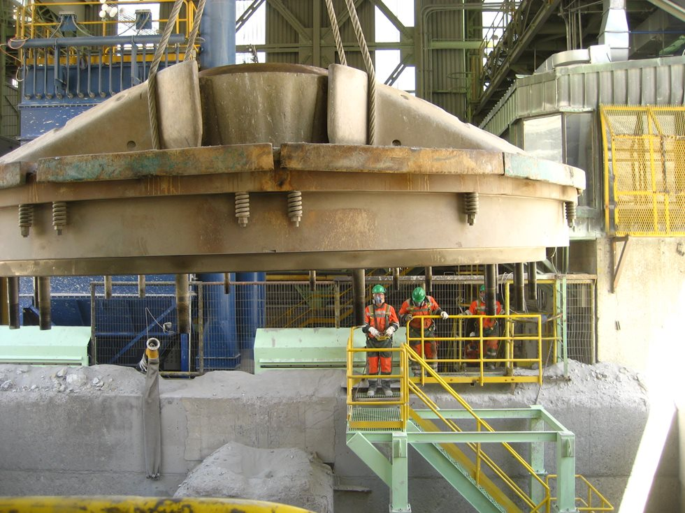 Primary gyratory crusher part being lowered.
