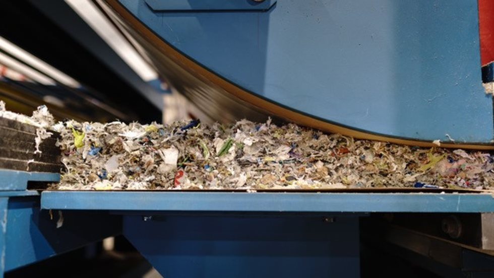 Shredded waste being processed.