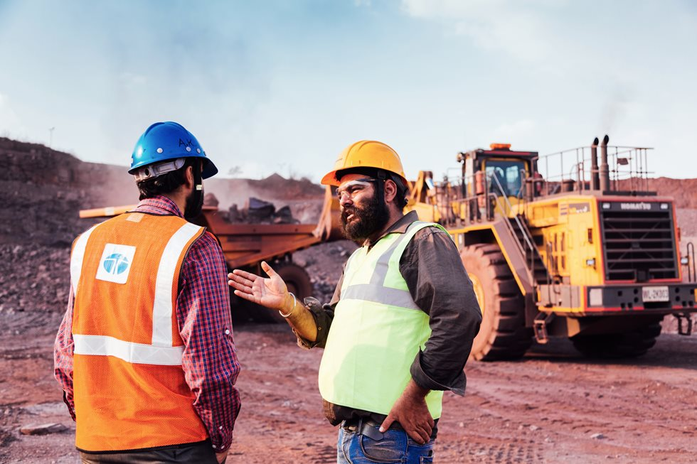 Two men discussing on a Tata Steel Khodbond's mining site.