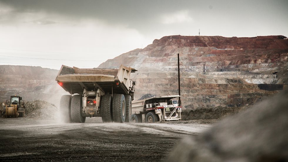 Full haul truck driving away at Grupo Mexico site.