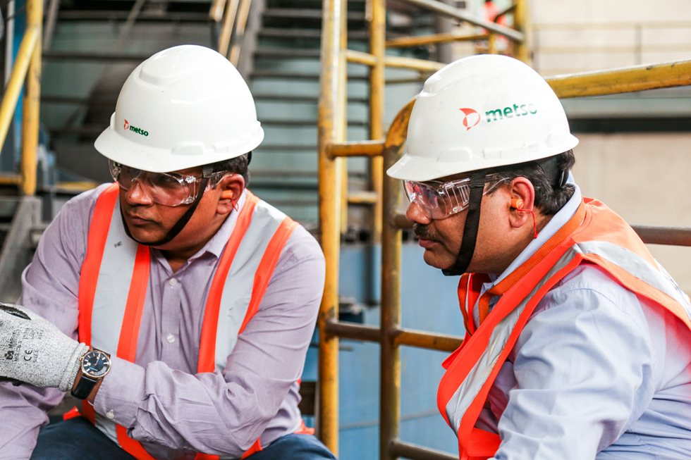 Two men in Metso helmets.